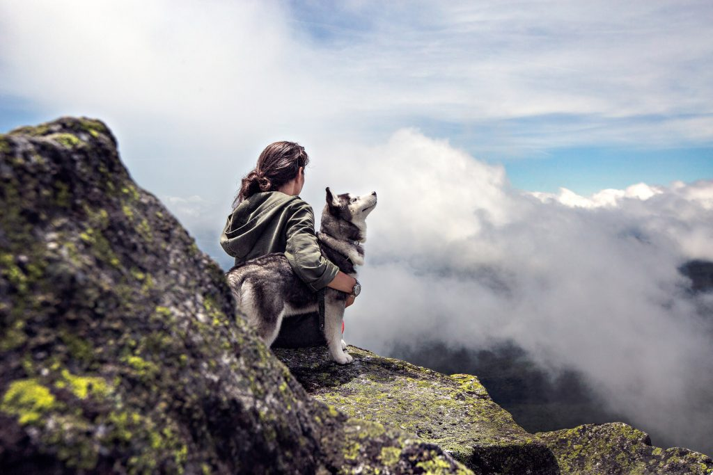 Adventure Girl Dog Mountain Clouds 4K Wallpaper