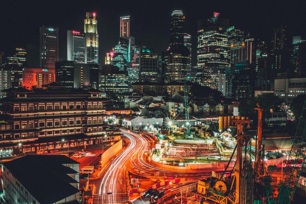 City Buildings Night Lights Road Traffic 4K Wallpaper