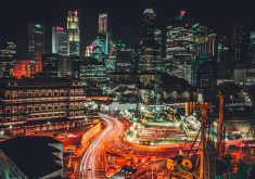 City Buildings Night Lights Road Traffic 4K Wallpaper