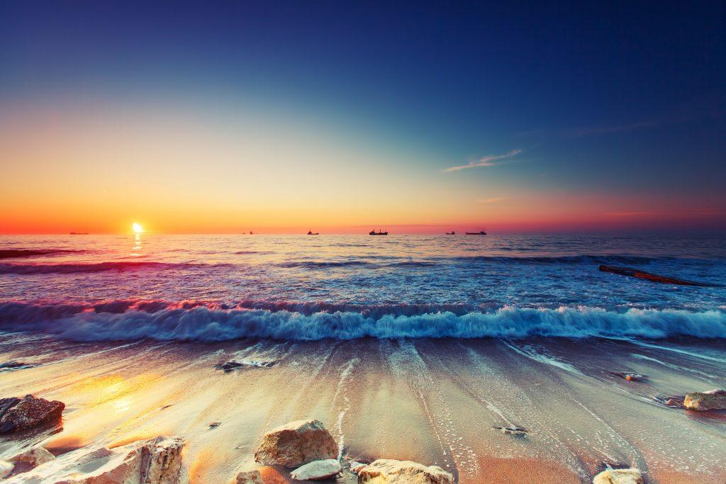 Ocean Water Wave Sunset Blue Sky 4K Wallpaper