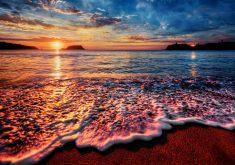Ocean Water Wave Sunset Orange Blue 4K Wallpaper