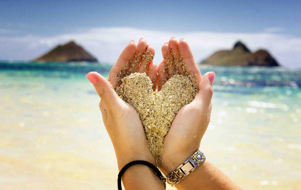 Hands Hold Sand Heart Beach Ocean 4K Wallpaper