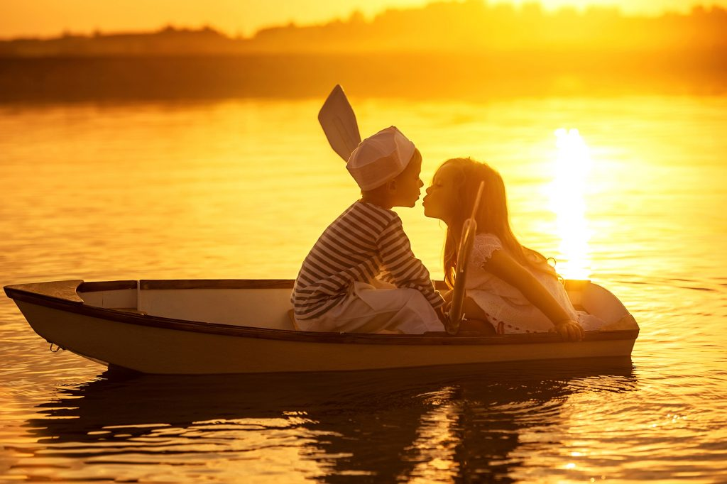 Kids Kissing Boat River Sunset 4K Wallpaper