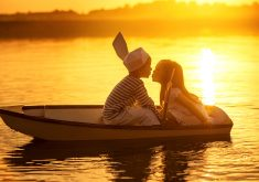 Kids Kissing Boat River Sunset 4K Wallpaper