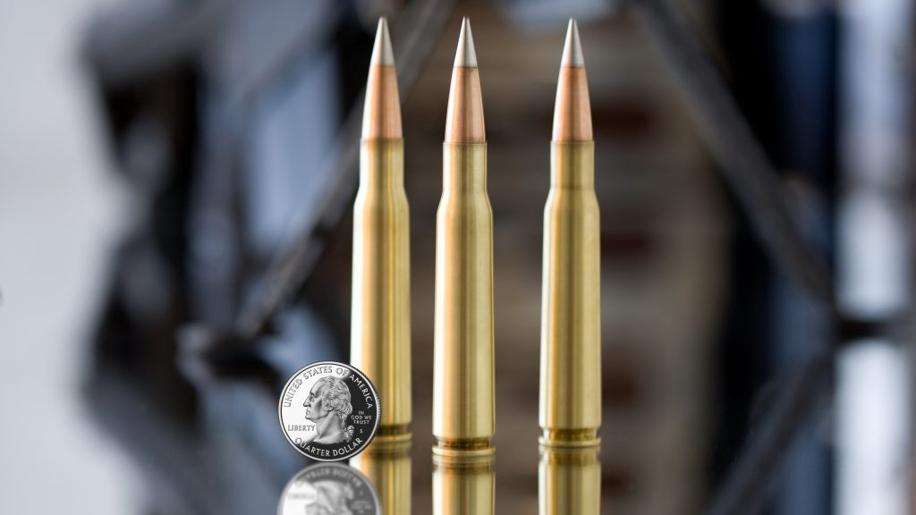 Machine Gun Bullets Silver Coin 4K Wallpaper