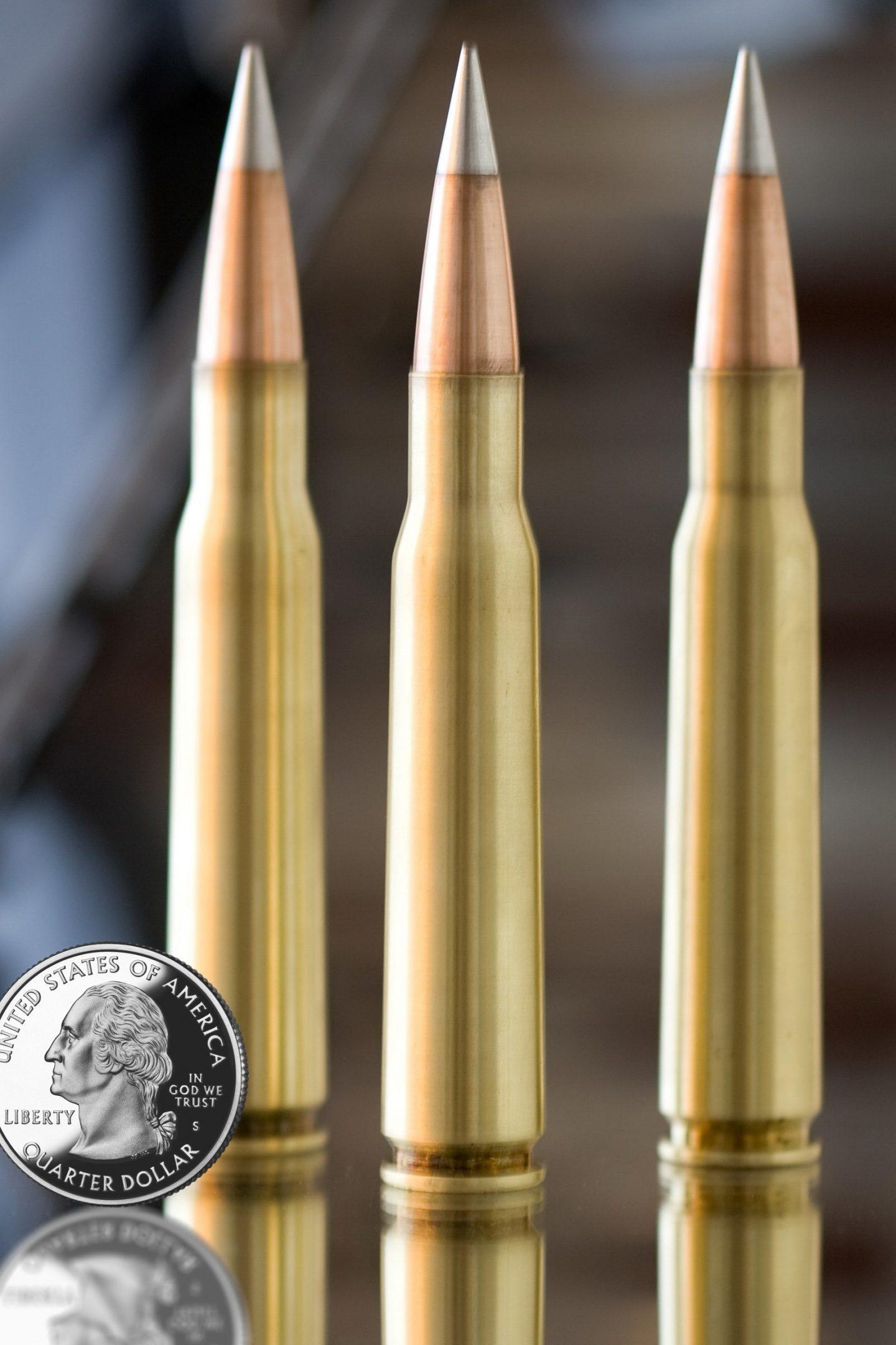 Machine Gun Bullets Silver Coin 4K Wallpaper