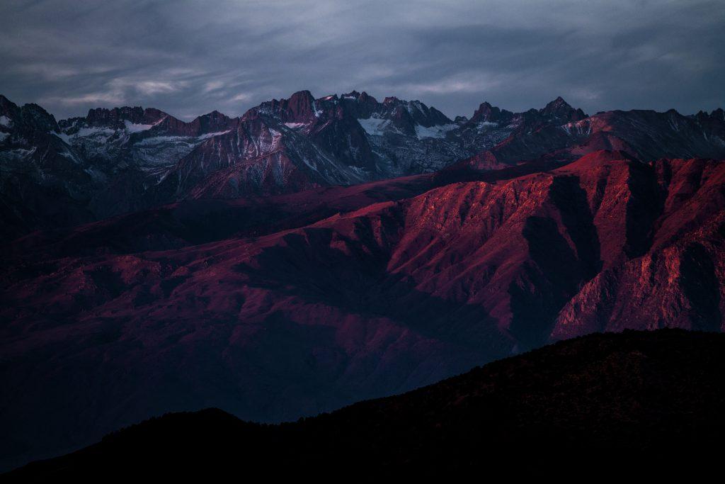 Mountains Rocky Snow Red White 8K Wallpaper